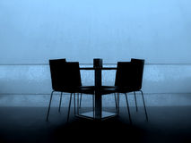Table. Black table with four chairs on blue background Stock Photos