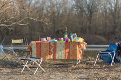 Table abundance of picnic on nature in spring. Royalty Free Stock Image