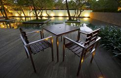 Free Table And Chairs Before Pool In The Evening Royalty Free Stock Photos - 14488338