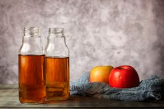 On the table is apple juice in a glass bottle stock photos