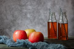 On the table is apple juice in a glass bottle royalty free stock photos