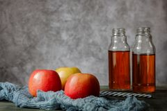 On the table is apple juice in a glass bottle royalty free stock images
