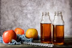On the table is apple juice in a glass bottle royalty free stock photo