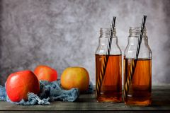 On the table is apple juice in a glass bottle stock photography
