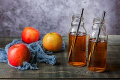 On the table is apple juice in a glass bottle royalty free stock image