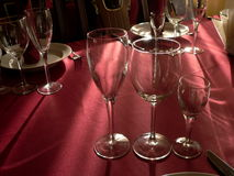 Table appointments. Wineglasses on purple tablecloth. To lay the table Royalty Free Stock Images