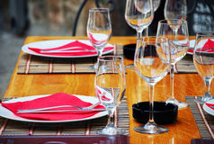 Table appointments. Wineglasses and plates on table in restaurant Royalty Free Stock Image