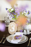 Table appointments and decor with flowers, number Stock Images