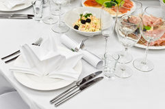Table appointments for dinner in restaurant Stock Image