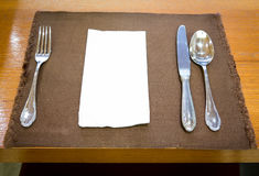 Table appointments (fork,knife,spoon, silk napkin) Royalty Free Stock Photography