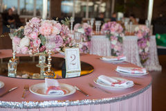 Table appointments in restaurant. Wedding preparation Stock Image