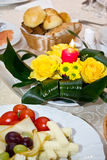 Table arrangement. Some plates with different kind of food with bouquet of yellow flowers stock images