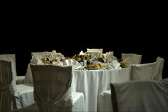Table arrangement. An arranged table in a restaurant isolated on a black background Royalty Free Stock Photography