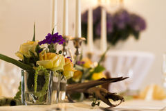 Table arrangement in a restaurant with flowers Royalty Free Stock Image