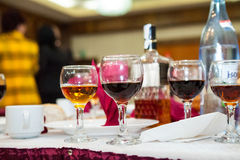 Table arrangement with wine glasses and caraffe Royalty Free Stock Image