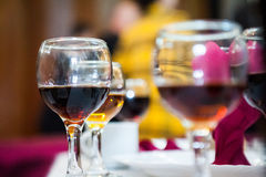 Table arrangement with wine glasses and caraffe Royalty Free Stock Images