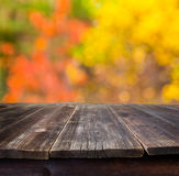 Table with autumn background Royalty Free Stock Image