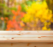 Table with autumn background Royalty Free Stock Photo