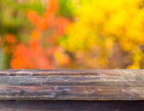 Table with autumn background Stock Photography