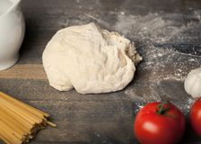 Ball of raw dough  on wooden table. Table background ball nobody fresh brown raw Royalty Free Stock Photography