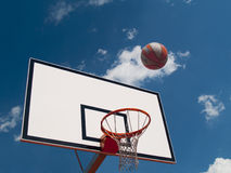 Table and Basketball. Photo shows a ball to the basket against the sky Royalty Free Stock Photo