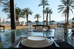 Table at the beach restaurant. In Eilat royalty free stock photography