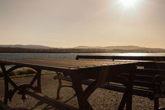 A table and a beach and the sun Stock Photography