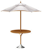 A table with a beach umbrella Royalty Free Stock Photography