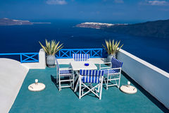 A table with a beautiful view over the sea and Santorini. A table with a beautiful view over the sea and the island of Santorini Stock Photography