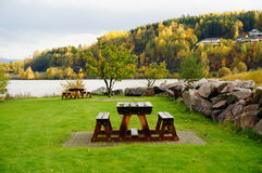 Table and bench on the background of fjord, Norway Stock Photo