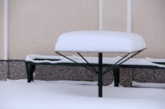 Table and bench covered with snow Royalty Free Stock Photography