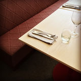 Table and bench in a restaurant Stock Images