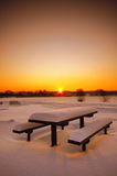 Table and benches. Beautiful winter sunset with a table and benches Stock Image