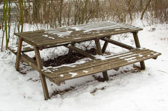 Table with benches. Old wooden table with two benches outdoor with snow Royalty Free Stock Photography