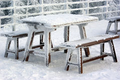 Table and benches. Snowly table and benches in winter forest Royalty Free Stock Images