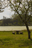 Table and benches by the lake. Lakeside picnic area at lagoa das Furnas, Sao Miguel, Azores, Portugal Stock Image