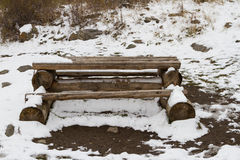 Table and benches made of logs. Table with benches in the first snow Stock Images