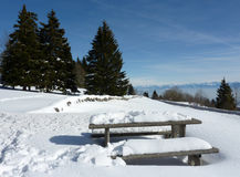 Table and benches in the mountain by winter Stock Image