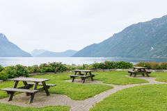 Table and benches for picnic on fjord shore. Norway Stock Photo