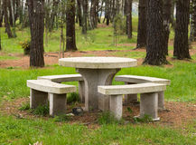 Stone table and benchs in a park Stock Photos