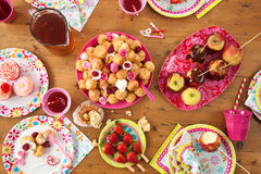 Table with birthday treats Stock Photography