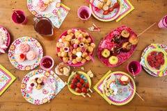 Table with birthday treats Royalty Free Stock Photo