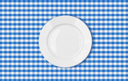 Table with blue picnic cloth and plate top view Stock Images