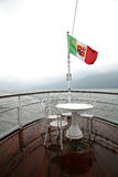 Table on boat. Table for four on the deck of a ship in the fog Stock Photo