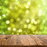 Table with bokeh background Stock Image