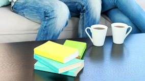 Table with books and coffee cups stock footage