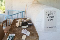 The table with books near the tombstone in the reconstructed tomb Rabbi Nakhman Katufa near the kibbutz Baram in Western Galilee i. Bar`am, Israel, June 09, 2018 Stock Images