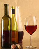 On the table a bottle of wine and a glass royalty free stock image