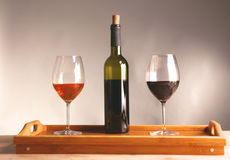 On the table a bottle of wine and a glass of.  royalty free stock images