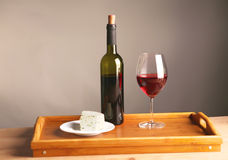 On the table a bottle of wine and a glass of.  royalty free stock image